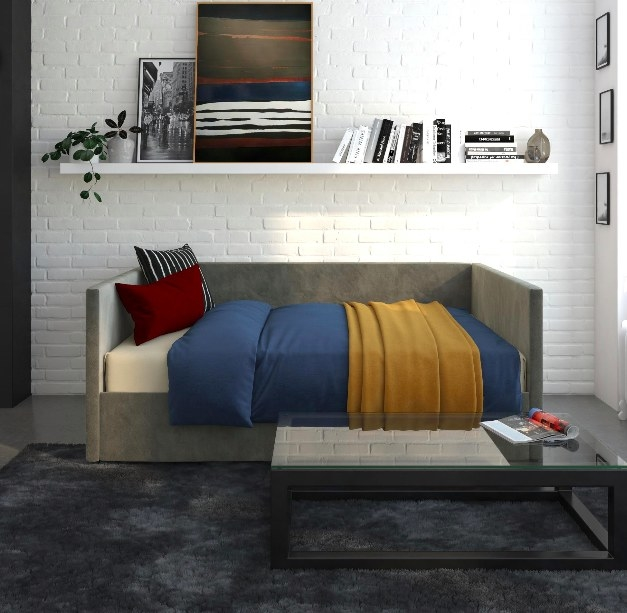 Gray daybed made into a comfy bed in a living room