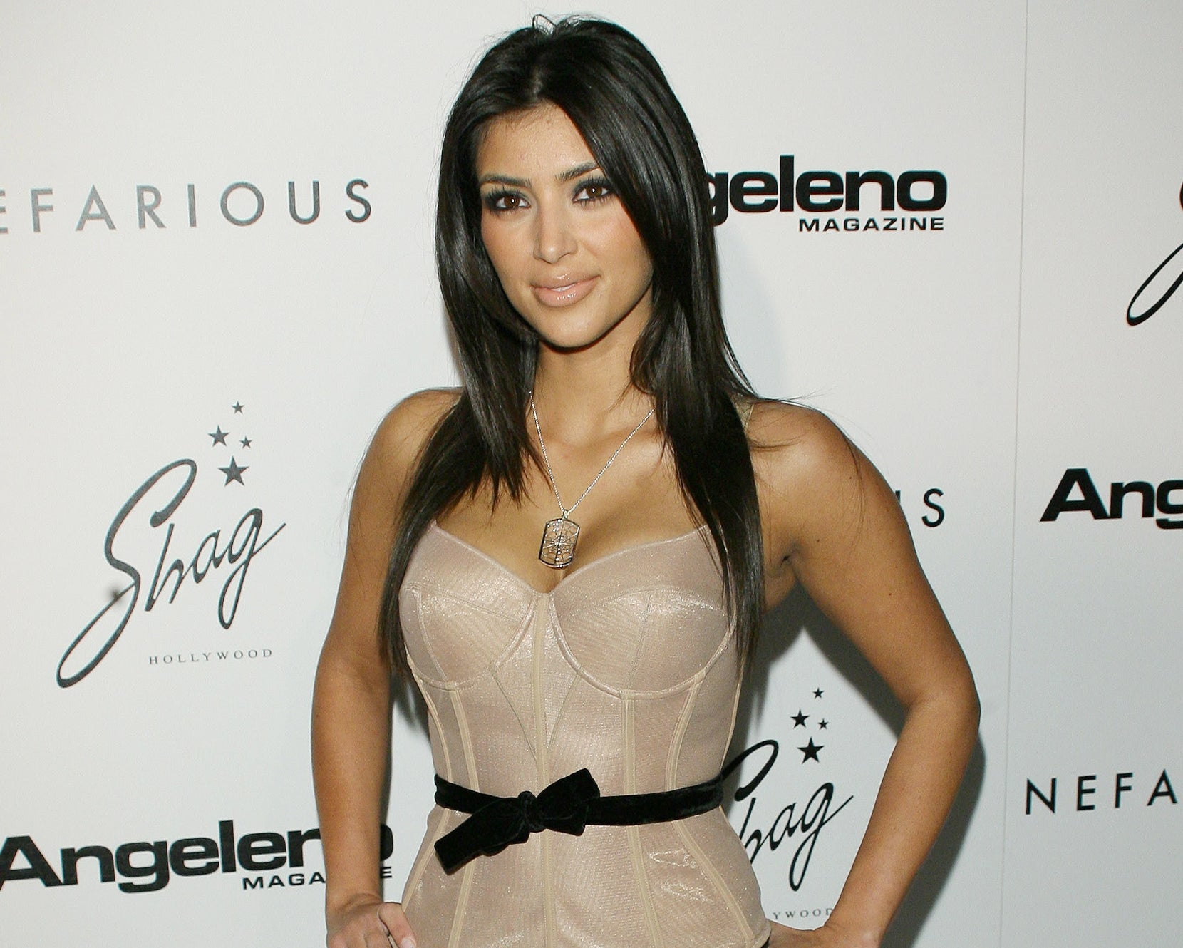 Kim wears a nude bustier top in an old event photo