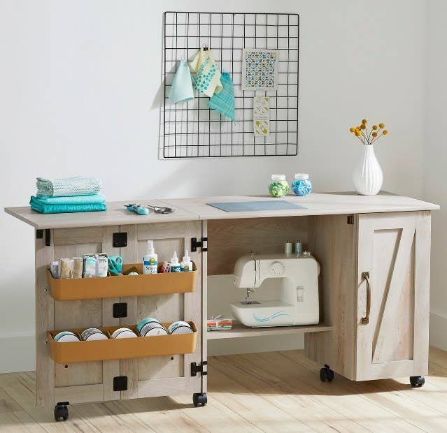 an open sewing table in a craft room