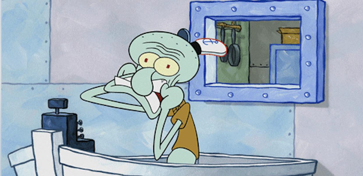 Squidward having a breakdown behind the register