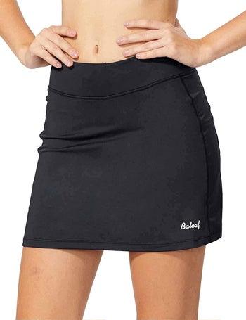 model wearing the black mini skirt