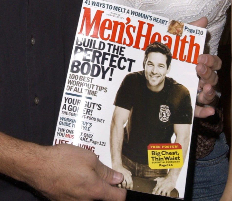 Eddie Cibrian holding a Men's Health issue with him on the cover