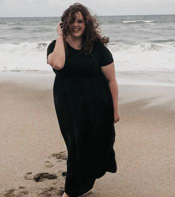 reviewer wearing a black dress