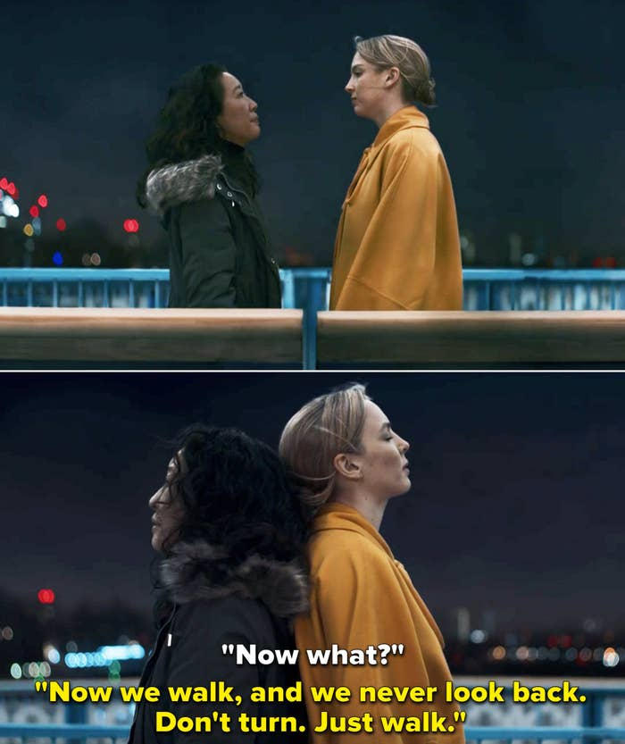 """Eve and Villanelle standing back-to-back and Villanelle telling Eve to """"just walk"""""""