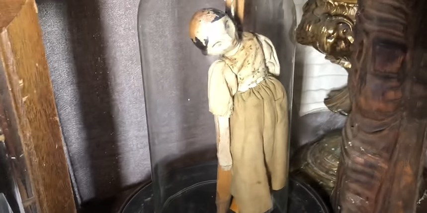 Doll hanging in a glass container