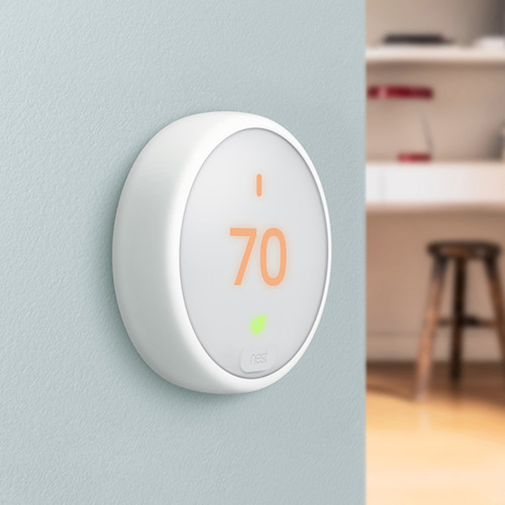 Google Nest Home Thermostat on a wall