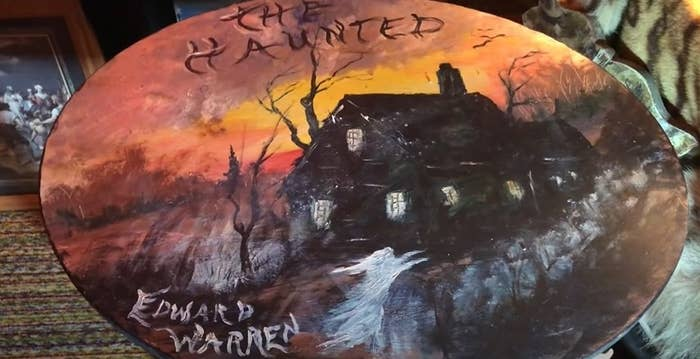 Table art of a house and ghost painted and signed by Edward Warren