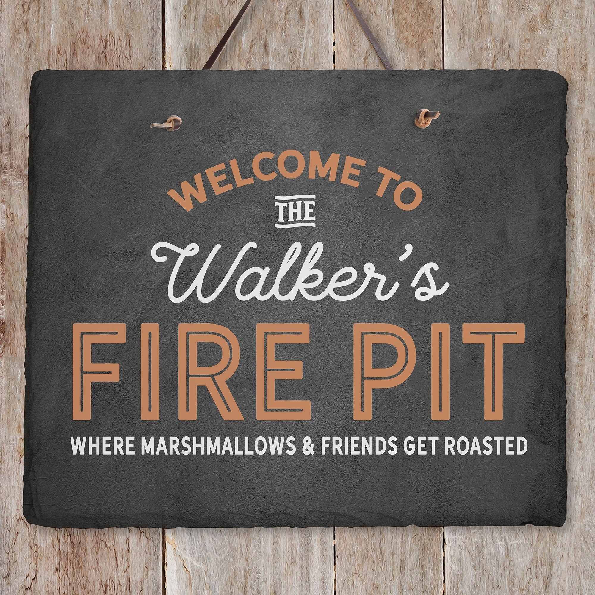 """A sign that says """"WELCOME TO THE Walker's FIRE PIT, WHERE MARSHMALLOWS & FRIENDS GET ROASTED"""""""