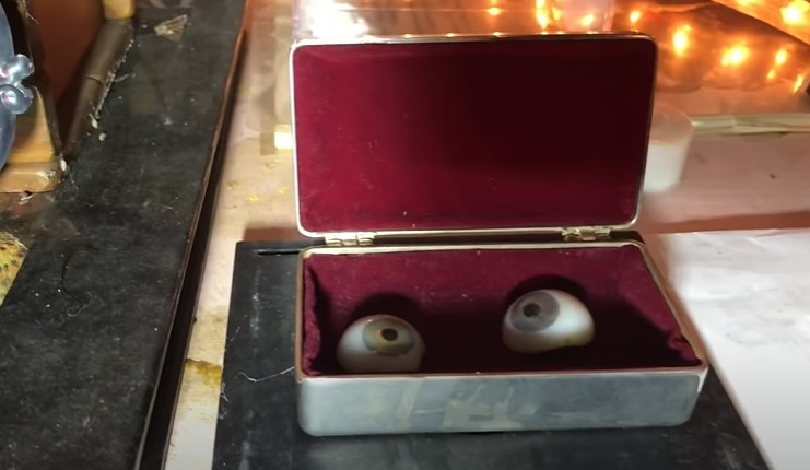 Two fake eyes inside a small container