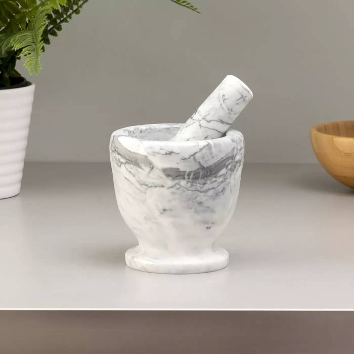The mortar and pestle in white marble