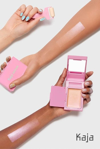 three hands with different skin tones holding the product with swatches of the highlighter on their arms