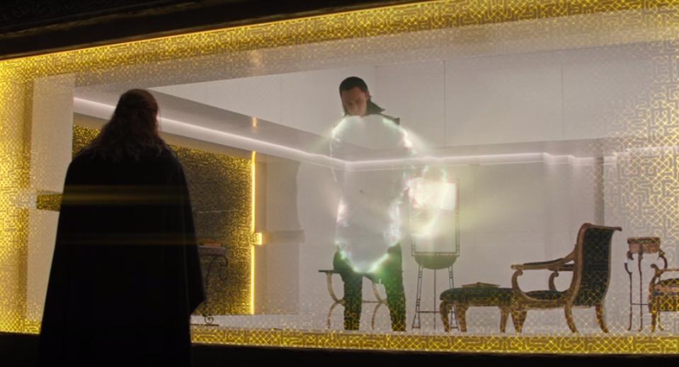 Loki in a scene using illusions to hide his true feelings