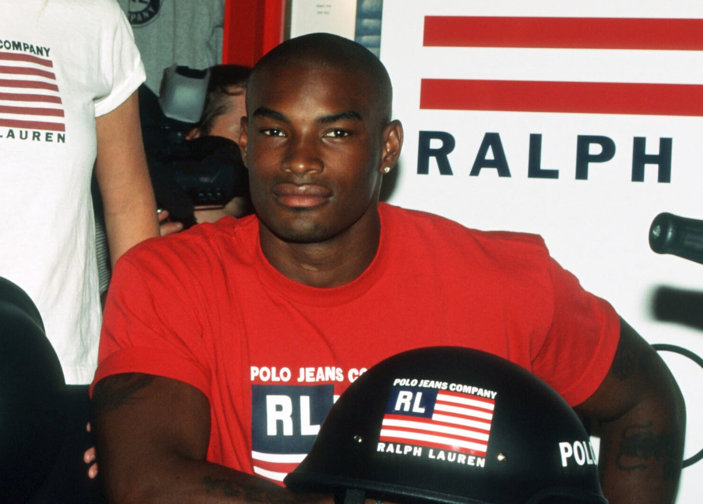 Tyson Beckford in a red Polo Jeans T-shirt at an in-store event for Polo
