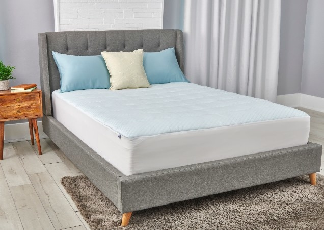 The mattress pad on a bed