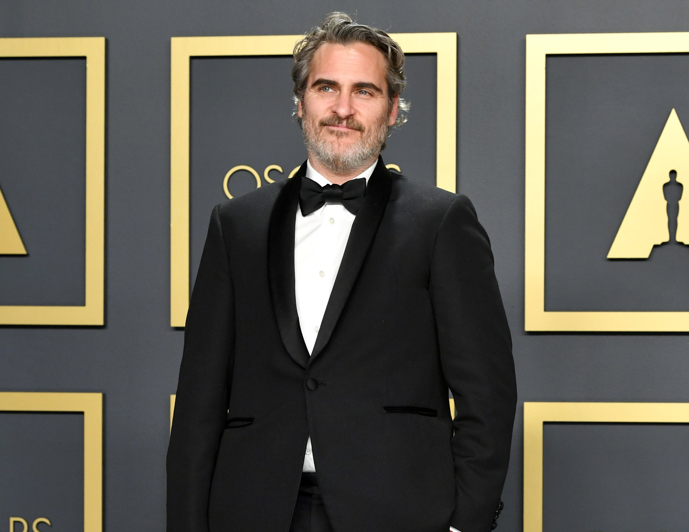 Joaquin stands backstage after accepting his award