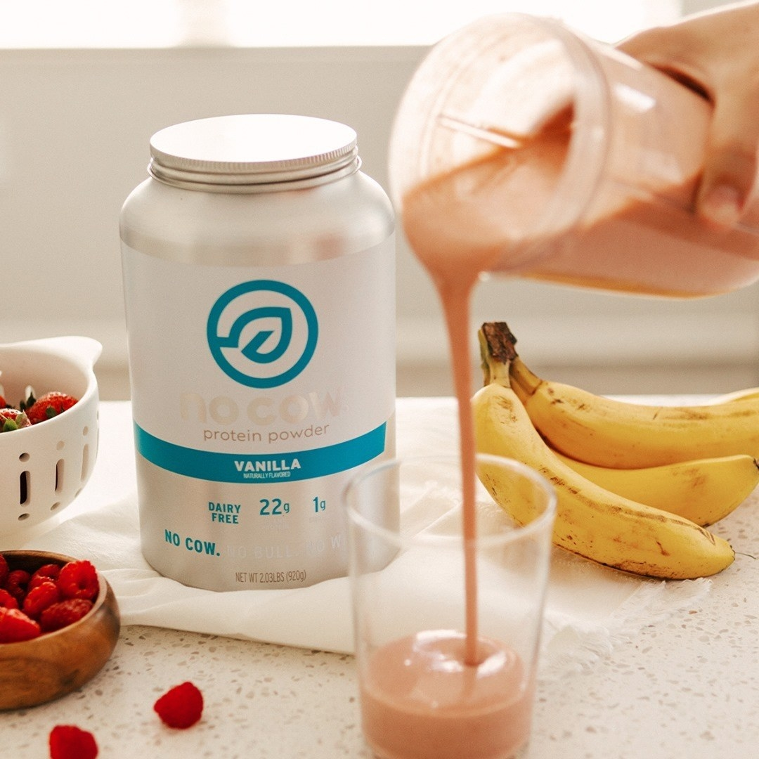 a photo of the eco friendly protein shake canister and a smoothie that someone made with the protein powder