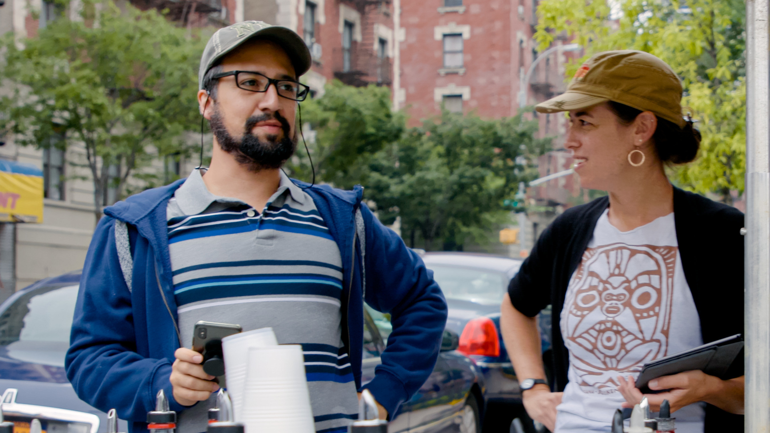 Lin and Quiara talking on the set of In The Heights