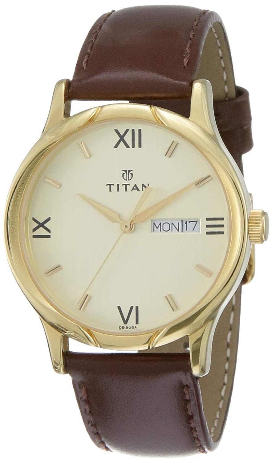 A watch with a brown leather strap and a golden dial