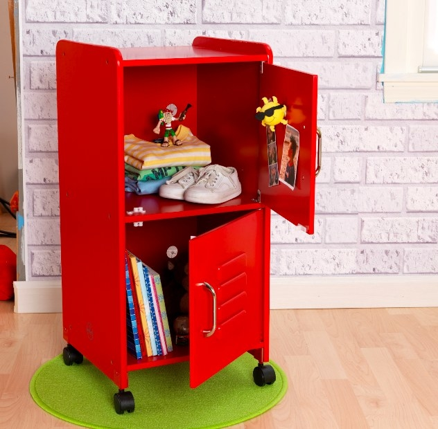 A red storage locker with the doors open to display storage of kid's clothes, shoes, and books