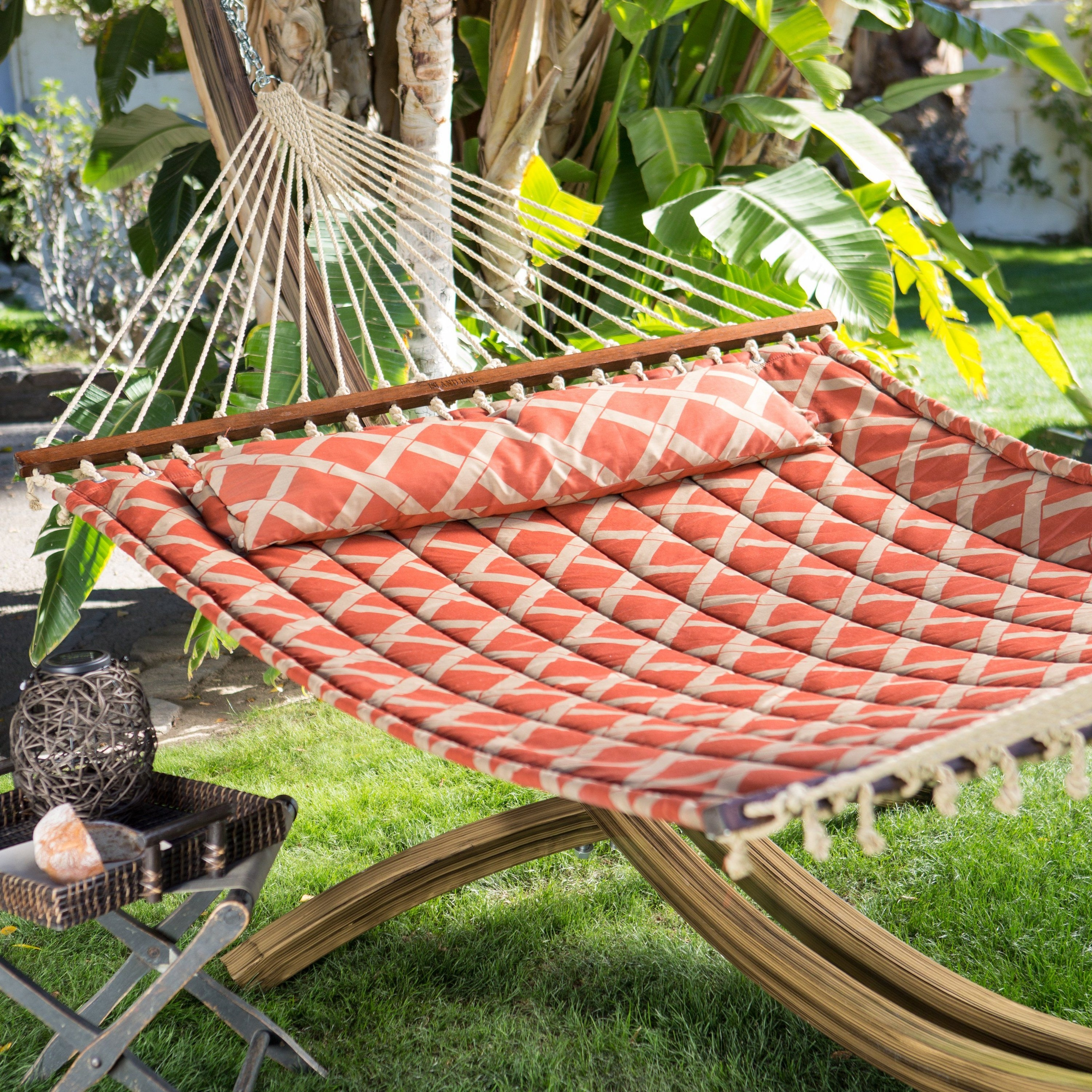 A quilted hammock wide enough for two people
