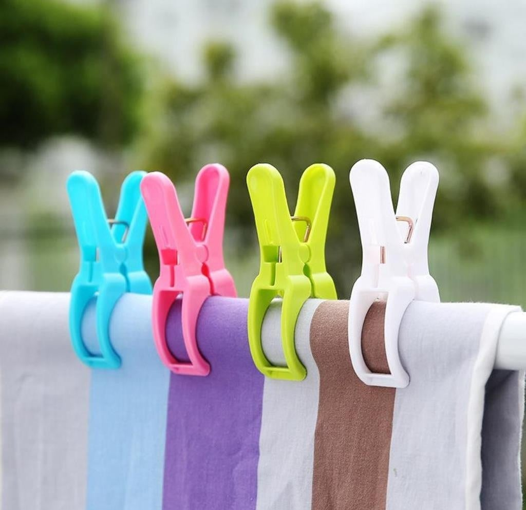 Four colourful clips holding a towel