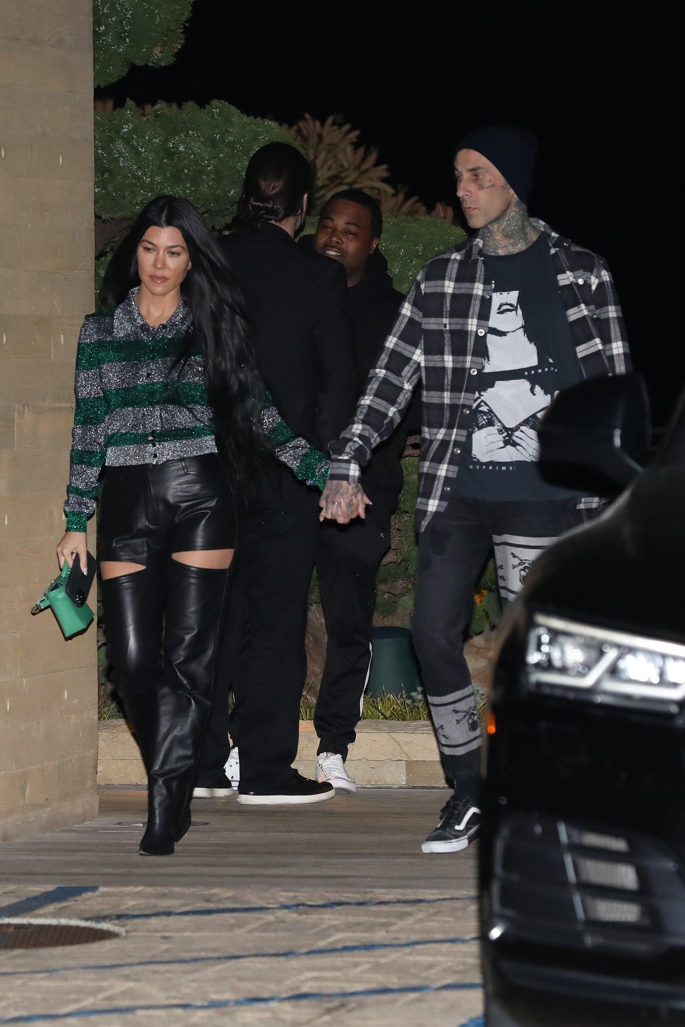 Kourtney Kardashian and Travis Barker are seen at Nobu restaurant on March 20, 2021 in Malibu, California