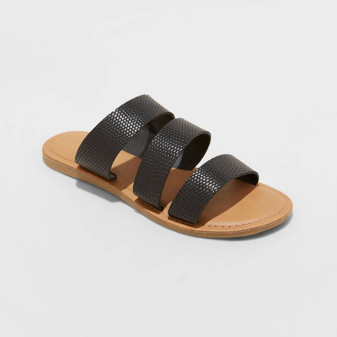 Black sandals with textured print and tan sole