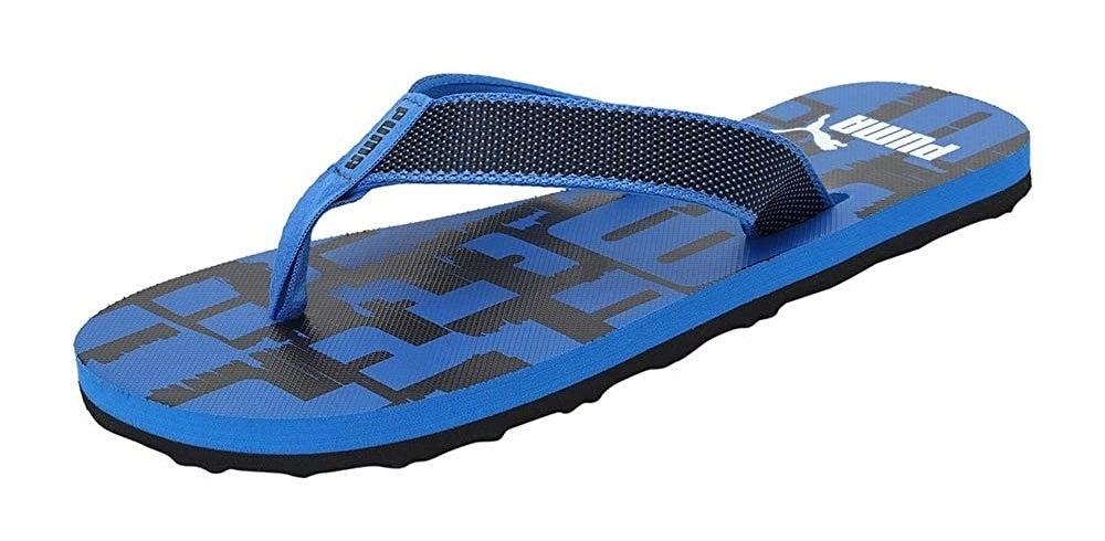 A singular Puma flip-flop in black and blue