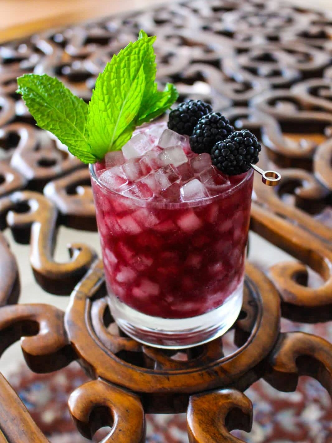 A blackberry julep mocktail garnished with blackberries and mint.