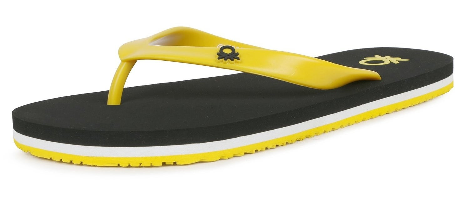 A singular UCB flip flop in black, yellow, and white.