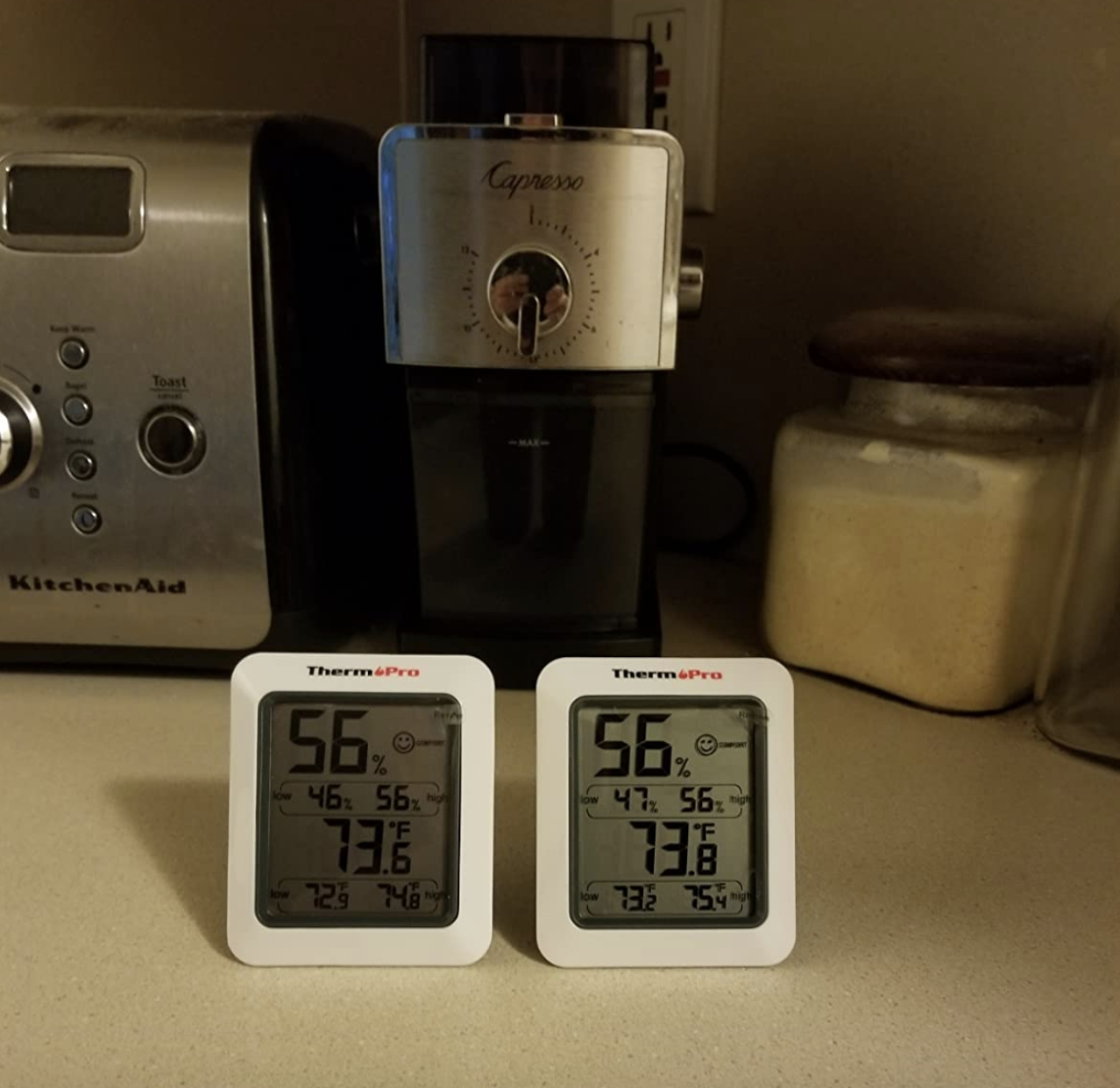 two of the thermometers next to each other on a kitchen counter