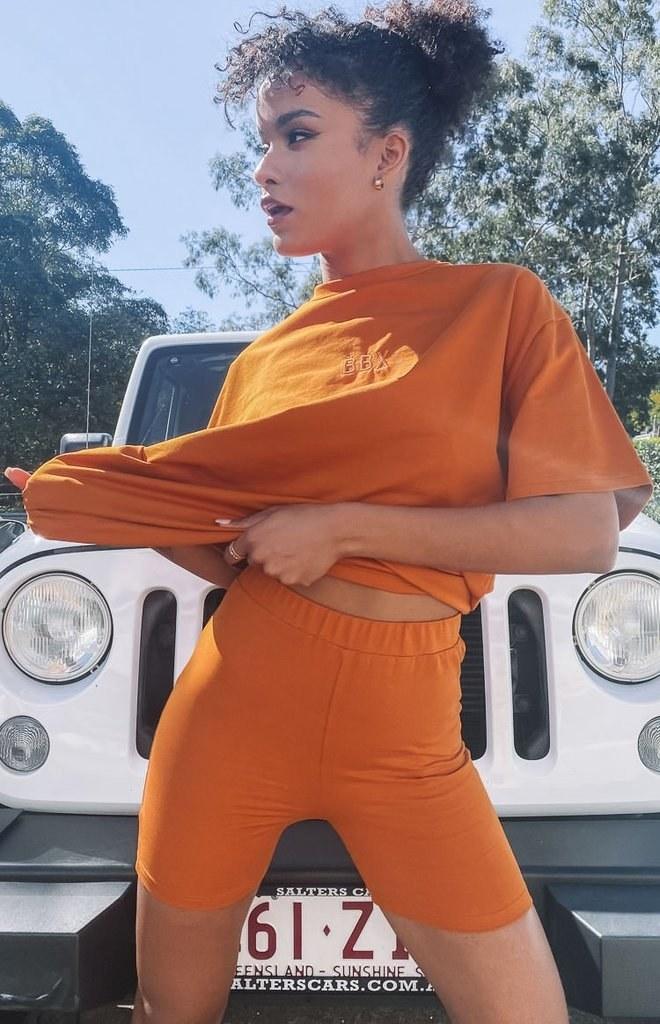 Model wearing Beginning Boutique Wellness shorts