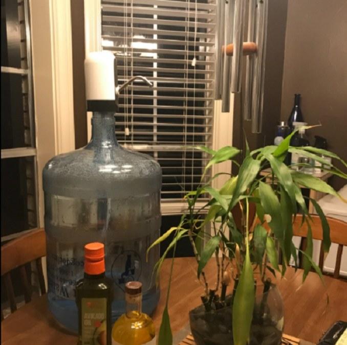An automatic water bottle dispenser