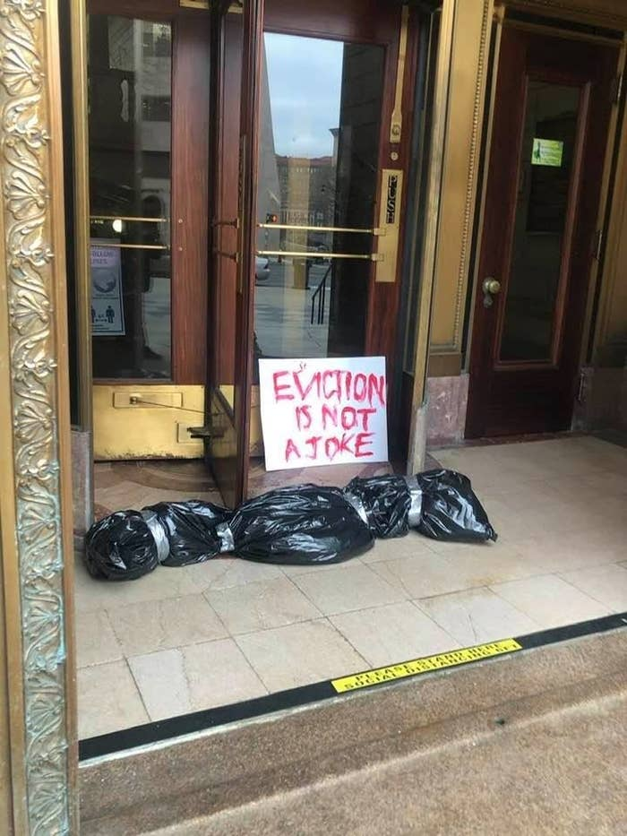 """Fake Body Bag placed at Hartford City Hall 4/1/21 with a sign reading """"Eviction is not a joke."""""""