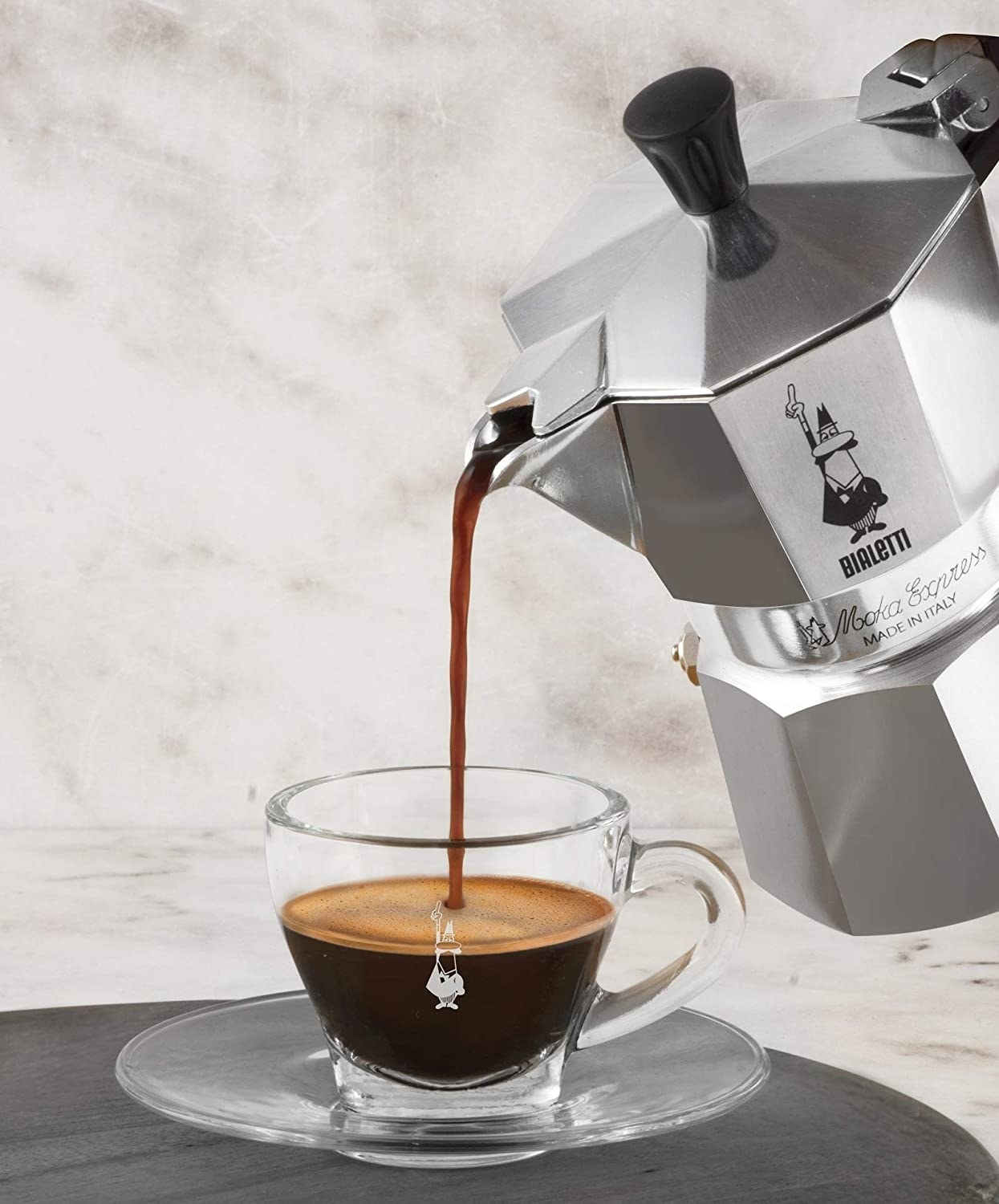 Coffee being poured into a cup from a Bialetti Moka Express Espresso Maker