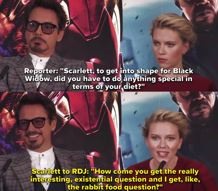 """Scarlett Johansson and Robert Downey Jr. sit next to each for a panel press conference for """"Iron Man 2."""""""