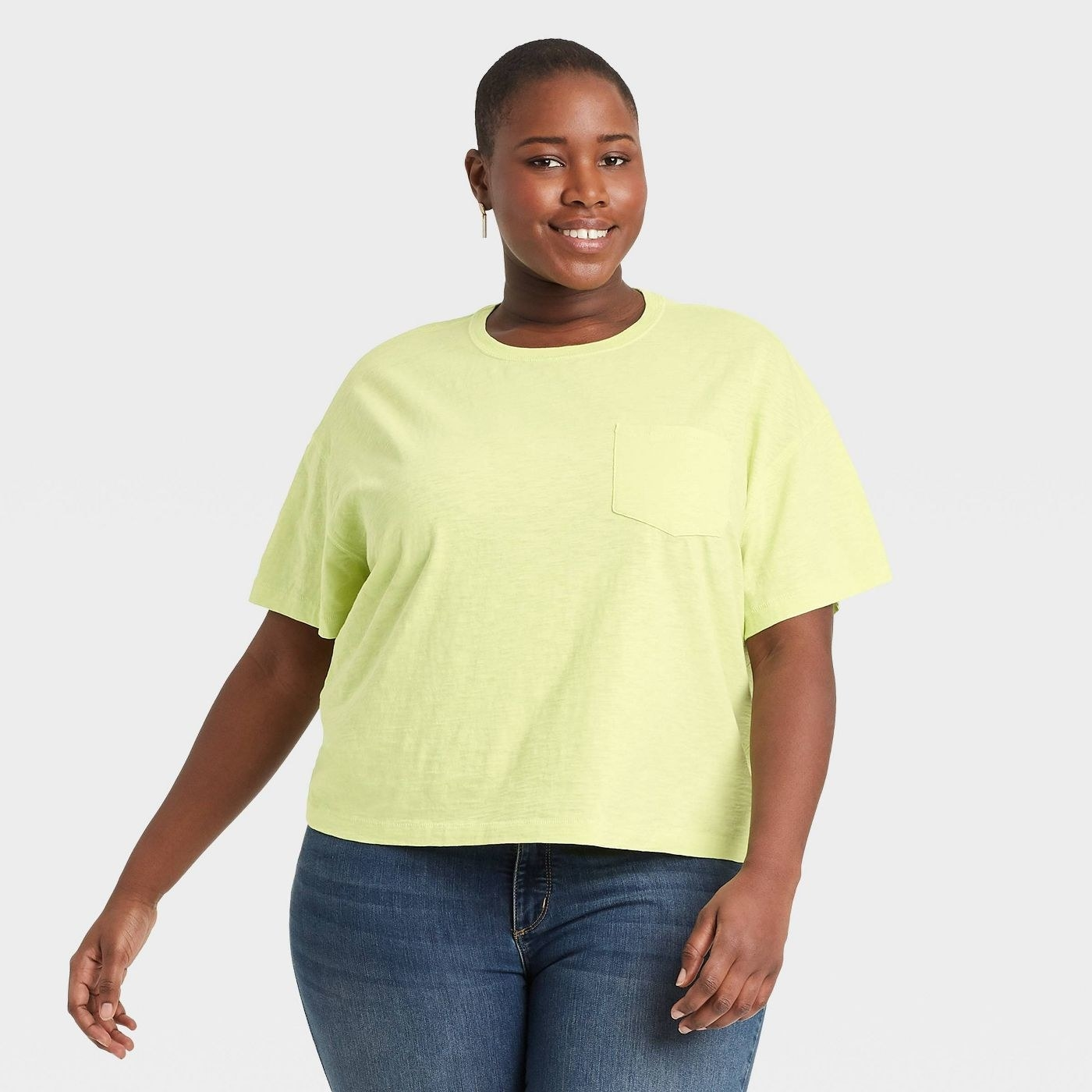Model wearing the top in bright green