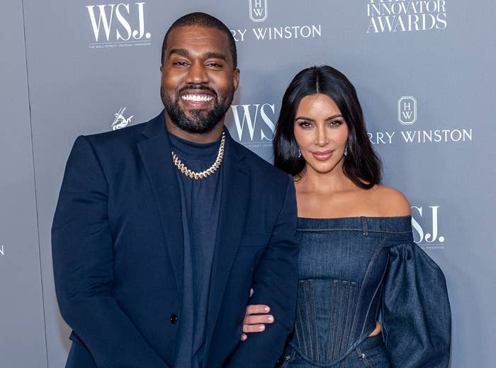 Kim and Kanye smile on a red carpet in happier times