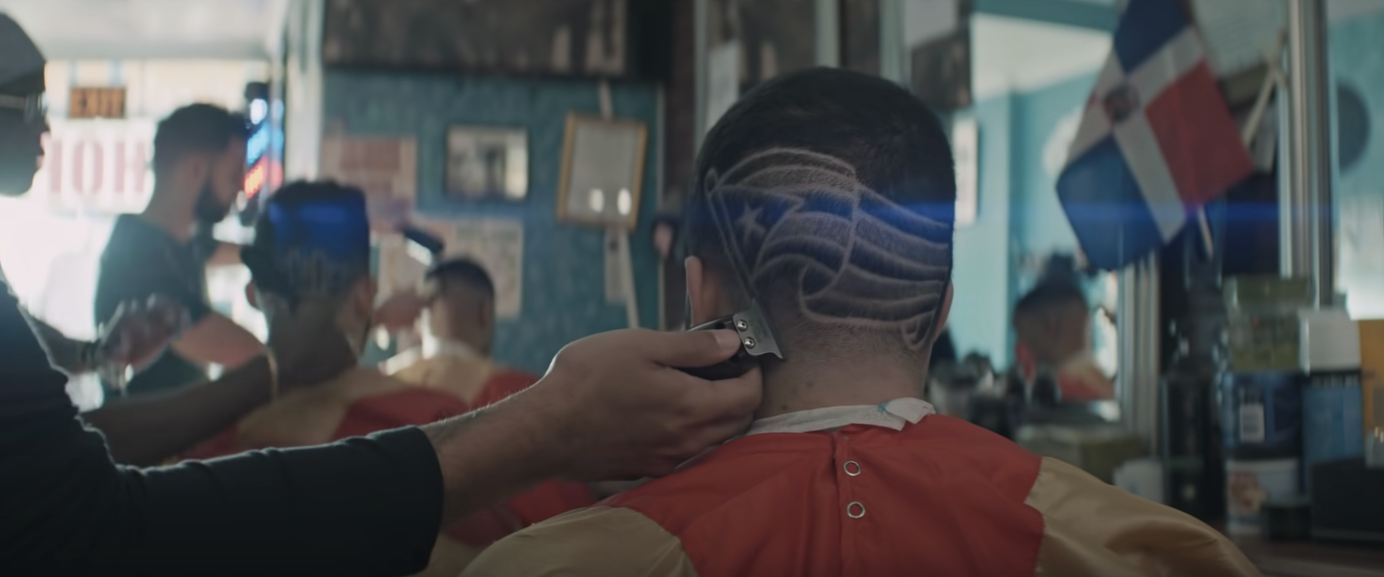 A Puerto Rican flag shaved onto the head of a man in In The Heights