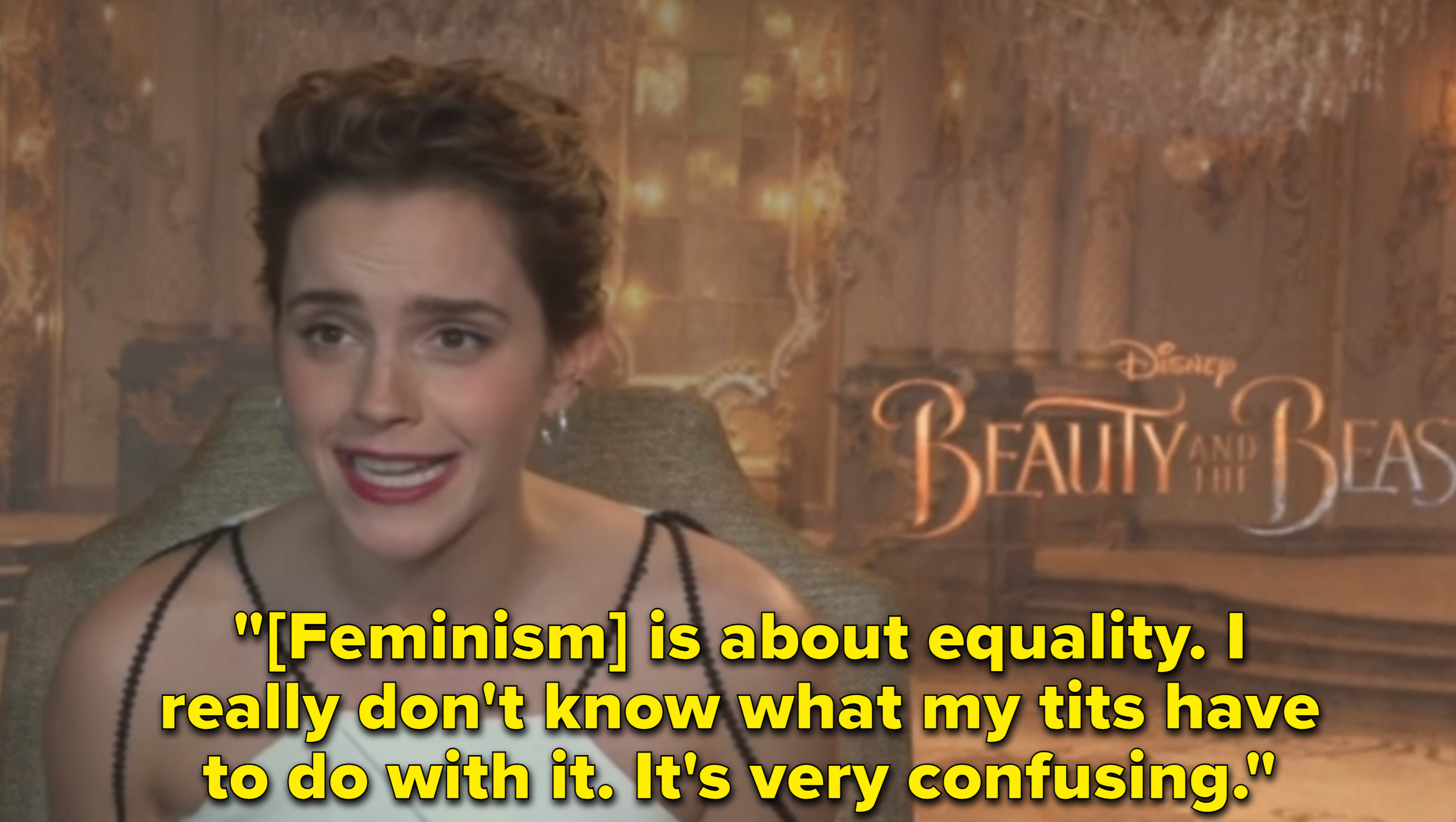 Emma Watson looks stunned as she explains that her topless photoshoot had nothing to do with her feminist activism.