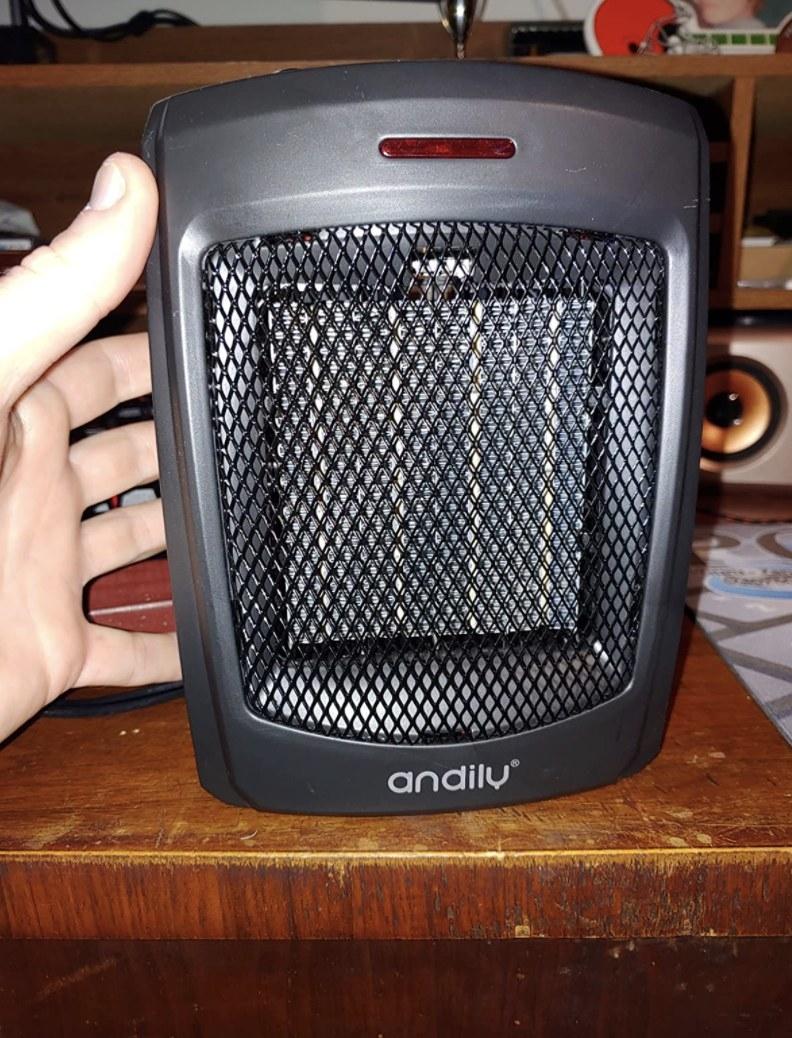 a reviewer's black heater on a dresser