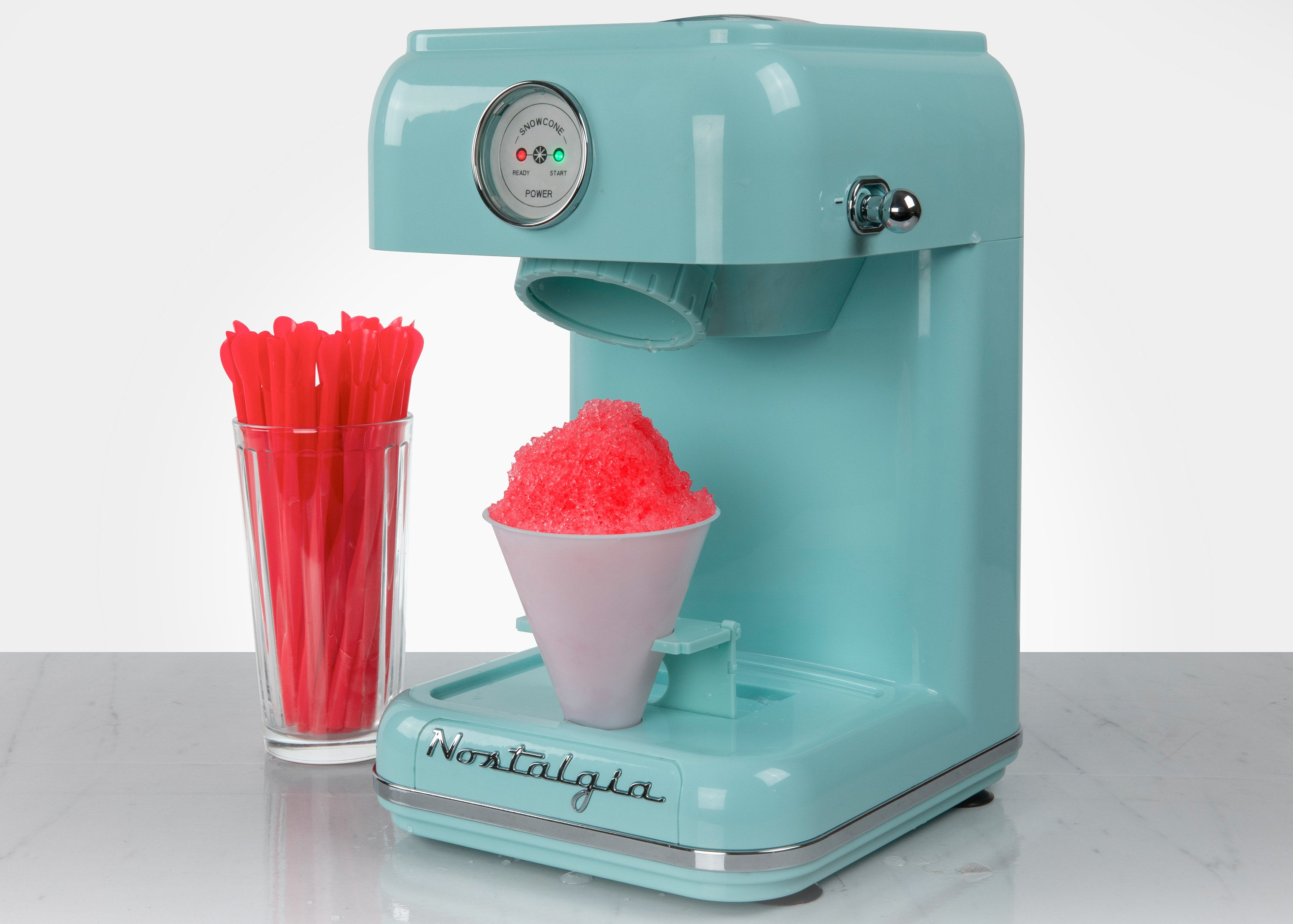 a small, aqua snow cone maker that deposits shaved iced and holds paper cones