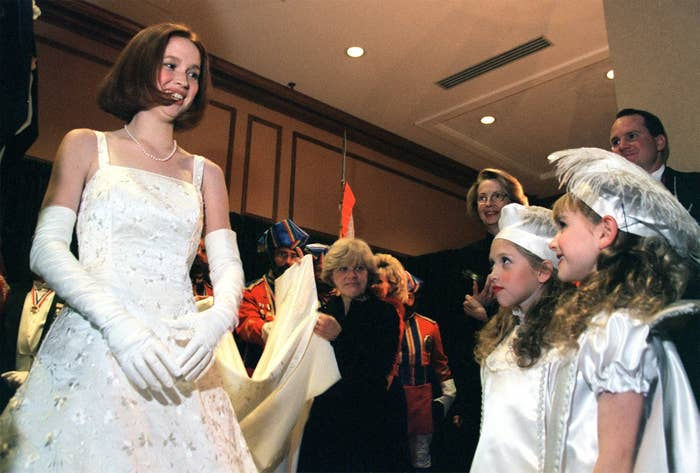 Elizabeth Claire Kemper, the 1999 Veiled Prophet Queen of Love and Beauty, speaks with pages Katy Angevine (left), 8, and Jacqueline Probst, 7, before going on stage Thursday night to accept her crown.