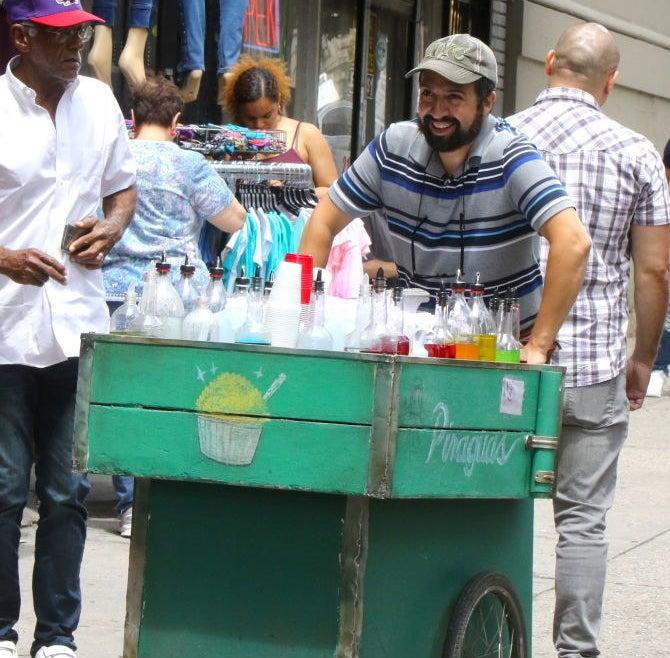 Lin pushing his piragua cart
