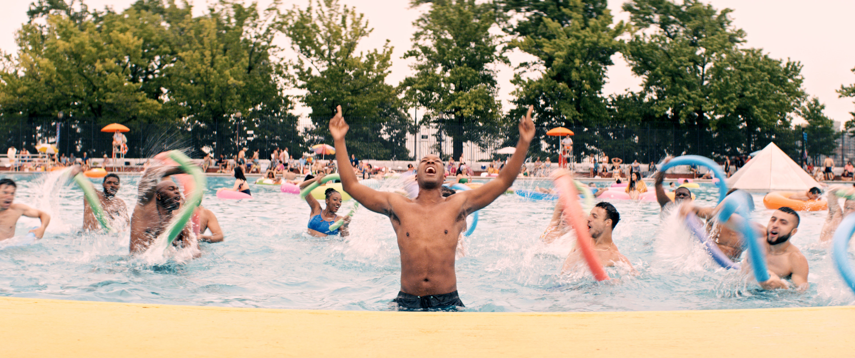 """People dancing in the pool during the """"96,000"""" musical number"""