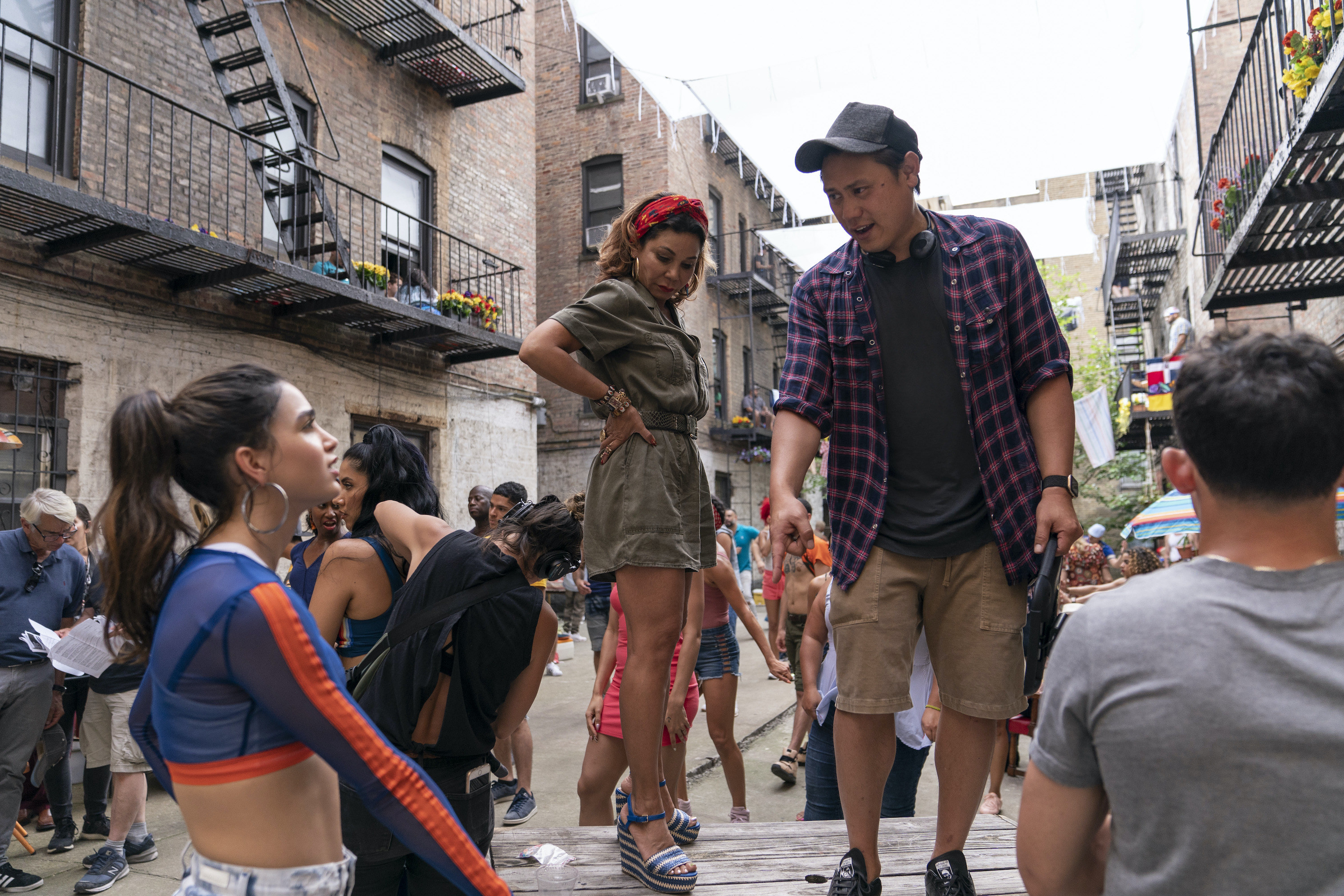 Jon giving direction to Melissa Barrera on set of In The Heights