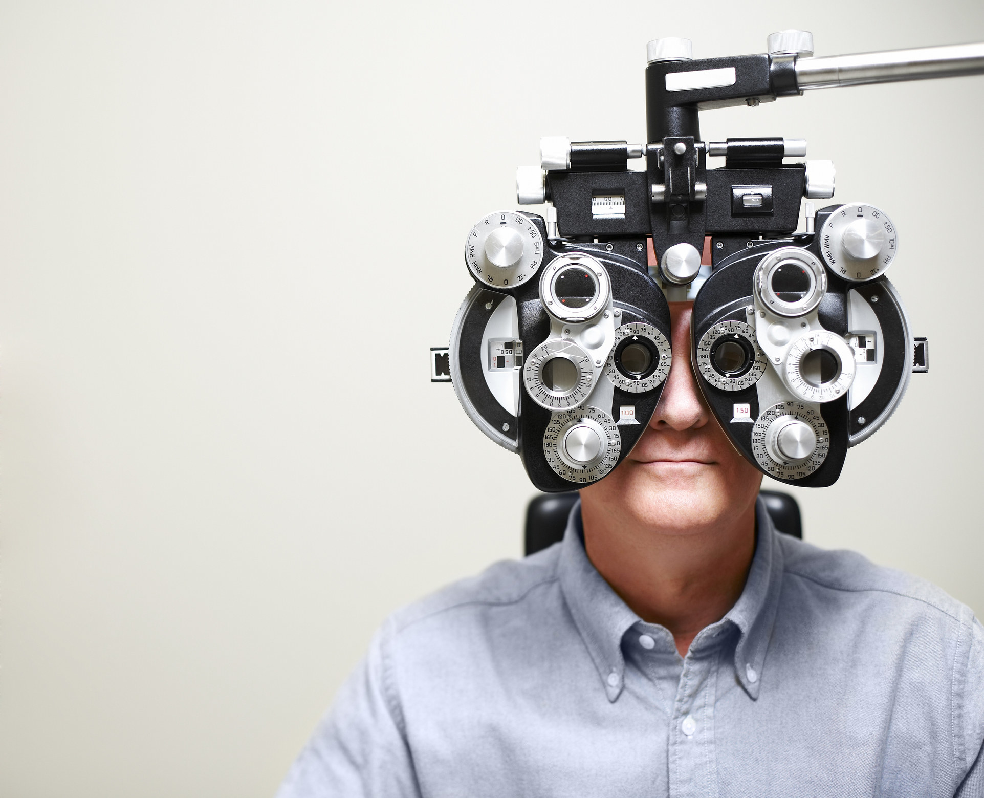 Guy looking into an eye-checking machine