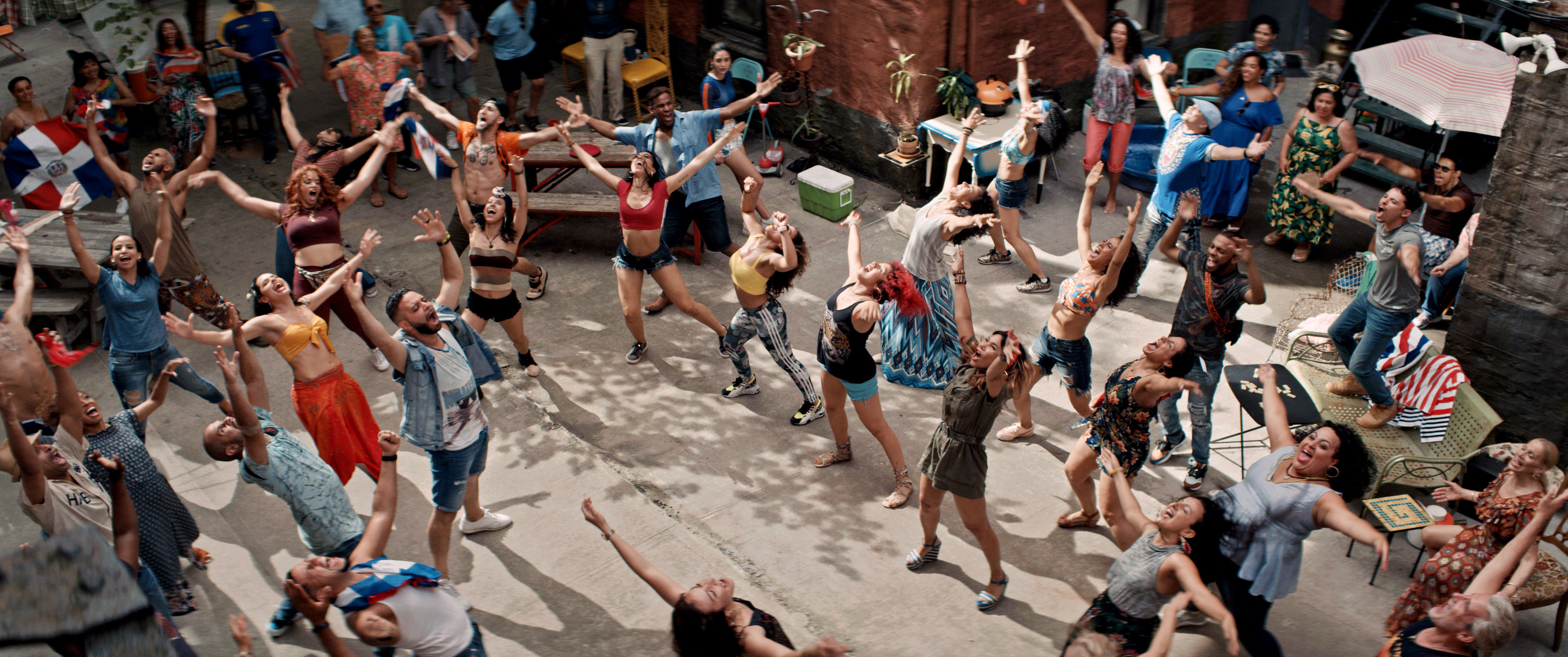 People dancing during Carnaval del Barrio in the film