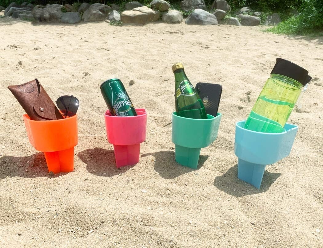 an orange, pink, teel, and light blue beach cup holder