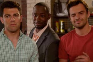 Schmidt frowns deeply, Winston smiles from his place behind Schmidt and Nick, and Nick is mid wink while smiling.